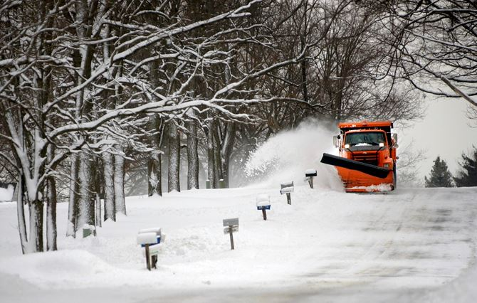 Muskegon Road Commission plowing snow along roadway